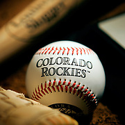 (DENVER, Co. - SHOT 3/29/2005).Photo of home plate, a baseball, a glove and a bat for the cover of the Colorado Rockies section for the home opener. The Colorado Rockies are a Major League Baseball team based in Denver, Colorado. They are in the Western Division of the National League. The team is named after the Rocky Mountains which pass through Colorado. They play their home games at Coors Field..(Photo by Marc Piscotty/ © 2005)