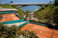 People play tennis at a country club near the ocean in the Miraflores neighborhood on Saturday, Apr. 4, 2009 in Lima, Peru.