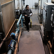 Robert Dawson, an operator in training, making his rounds of the plant as he conducts water quality tests at the water treatment plant at the Ochiichagwe'Babigo'Ining Ojibway Nation reserve (also known as the Dalles First Nation) in Northern Ontario, Canada on 15 December 2016. Ph, alum, temperature, turbidity and chlorine level tests are conducted routinely, together with tests to monitor carcinogen levels as, according to operators, water-borne carcinogens are one of the legacies of industrial pollution of the Winnipeg River from which the community draws its water. The water treatment plant is participating in a pilot program which will see water quality monitored in real time via an Internet link to a central Water Hub at the Bimose Tribal Council in the town of Kenora, about 30 minutes drive away.