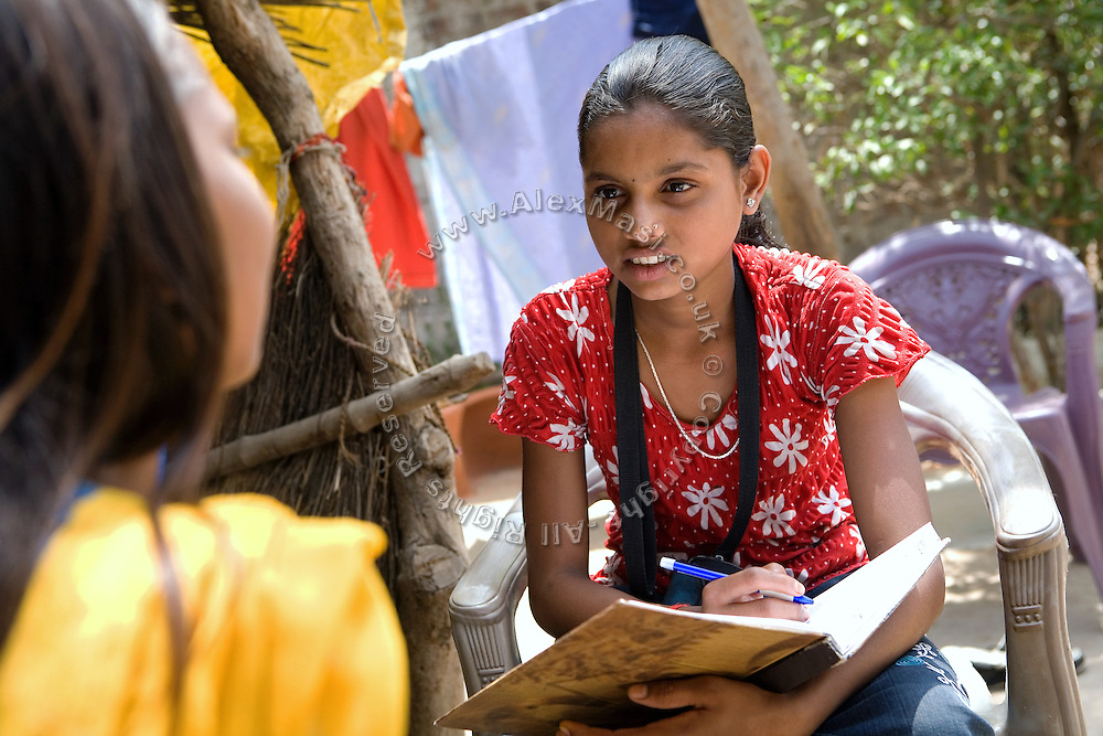 Pooja, 14, a student from the village of Pathpuri, Hoshangabad, Madhya Pradesh, India, taking part to the children's journal, a project launched by Dalit Sangh, an NGO which has been working for the uplift of scheduled castes for the past 22 years, is interviewing a young villager in her home. Dalit Sangh is working in collaboration with Unicef India to promote education and awareness within backward communities.