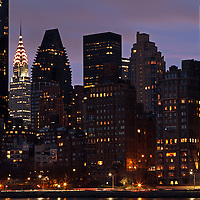 NYC night photography image of the Manhattan East Side showing iconic New York City architecture of Art Deco architecture Chrysler Building and the famous Donald Trump Tower. <br />