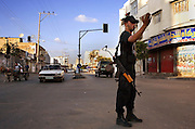 A Hamas security force policeman directs traffic August 05, 2007 in Gaza City, Gaza. More than 1,000 Hamas policemen are deployed on corners across Gaza these days, directing traffic and community policing on foot and by truck.