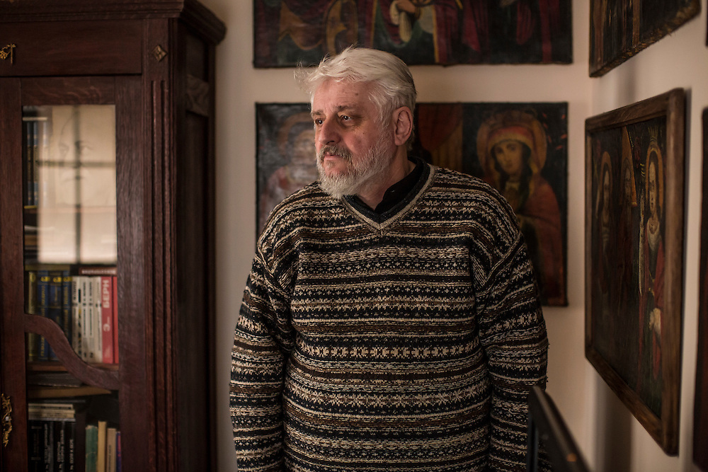 ODESSA, UKRAINE - MARCH 26, 2015: Poet Boris Khersonsky poses for a portrait in his home office in Odessa, Ukraine. He is surrounded by some of the Ukrainian Orthodox religious icons which he collects. CREDIT: Brendan Hoffman for The New York Times