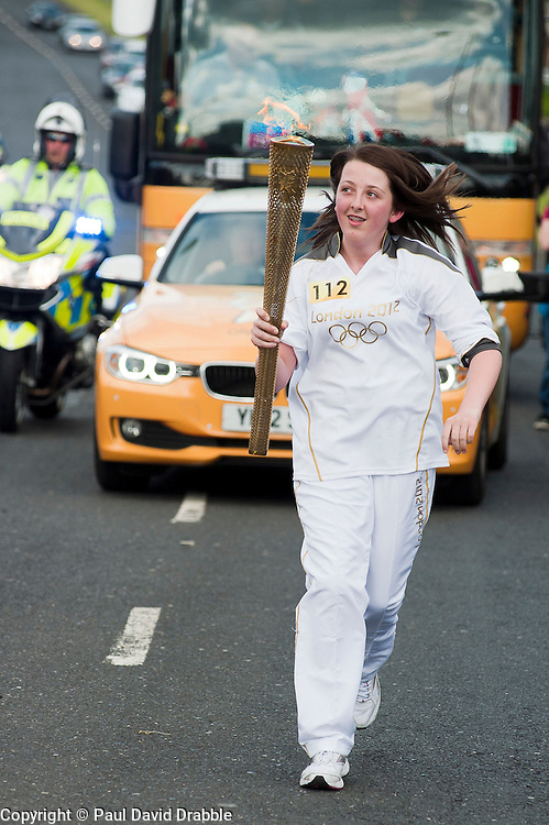 The Olympic Torch relay reaches Sheffield on day 38 coverage from the Chapeltown - Ecclesfield - Parson Cross section of the Journey.<br /> Olympic Torch Bearer 112 Ashley Jeeves aged 14<br /> 25 June 2012.<br /> Image &copy; Paul David Drabble