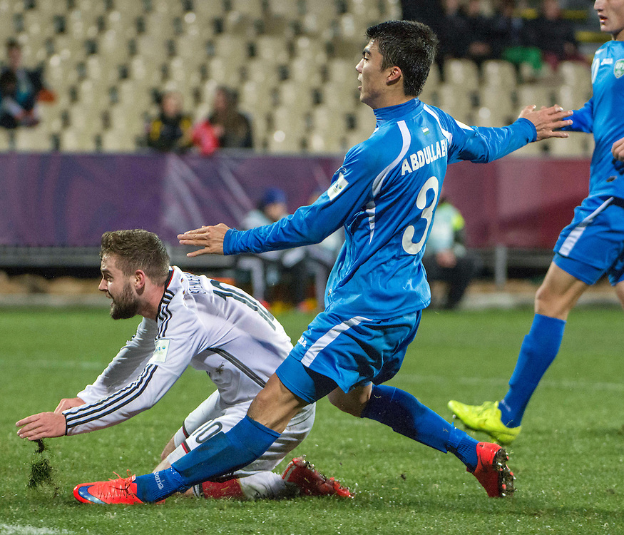 Marc Stendera of Germany, left, charges in to score a goal pursued Ibrokhim Abdullaev of Uzbekistan in the Under 20 soccer World Cup match, Christchurch, New Zealand, Thursday, June 04, 2015. Credit:SNPA / David Alexander