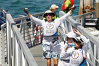 1 August 2015: Special Olympic World Games Los Angeles Sailing Finals in Long Beach, California.  Team USA #56 Jessie Kuykendall, #57 Robert Bobby Lord and Unified Partner Angelina Litton wave to fans after final race in Cal 20 boat during final day of sailboat racing in Los Alamitos Bay.
