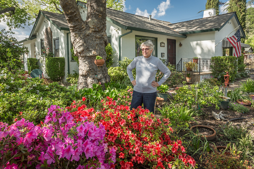 """""""I was born in this house and the only way I'm leaving is with a toe tag!""""  -Sonya Spencer takes a break from gardening in front of her house on Lake Street in Calistoga."""