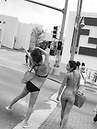 Japanese tourists, fresh from the beach in their bikinis, cross towards the Fendi designer brand goods store in Tumon, Guam, on Saturday, Mar. 10, 2007.  Sometimes known as 'America in Asia', Guam is a popular destination for Japanese tourists ( accounting for approx 90% of the island's visitors) with average visitor numbers from Japan approaching 1million.  The island, a 3.5 hour flight from Japan, has more than 20 large hotels and numerous duty-free shopping malls catering to the Japanese tourists predilection for designer brand name goods, as well as golfing and other water based entertainment features. In 2007-2008 US military personal currently stationed in the Japanese Okinawan Islands will relocate their bases and operations  to Guam, helping to stabilise the island's economy which suffered after tourism decreased in recent years due to a  fear of flying by Japanese post 9-11 World Trade Centre disaster, a 2003 typhoon and the SARS disease outbreak in Asia.