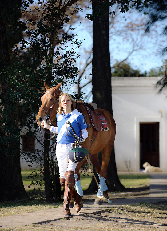 Buenos Aires Province, Argentina 20 August 2009<br /> Silke Olscher, manager of Estancia La Sofia, and her polo horse, after a training.<br /> The Polo is a typical Argentinian team sport played on horseback in which the objective is to score goals against an opposing team.<br /> A game first played in Persia at dates given from the 6th century BC, or much earlier,to the 1st century AD and originated there.<br /> Polo was at first a training game for cavalry units, usually the king's guard or other elite troops. <br /> PHOTO: EZEQUIEL SCAGNETTI