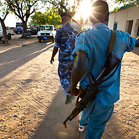 A police officer walks through the Abyei police station.