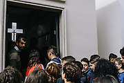 Throngs of residents visit the grave of  Giuseppe Diana, a local priest that was murdered by the Mafia for instructing his parishioners to shun the Camorra. Every year on March 20, thousands march through the city of Casal di Principe chanting as they walk, telling the Mafia they are not going to allow the organized crime to continue ruling the land.