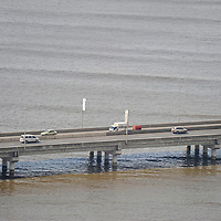 The marine section of Corredor Sur highway cuts across the Bay. Part of the road is constructed over land and part over Panama Bay near the coastline.