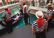 "Actors portray gondoliers while giving visitors rides on the Venetian Hotel and Casino ""canals, "" Tuesday, April 20, 2004.  The attraction is modeled after the Italian city built on water and in a city, Las Vegas,  built in a desert.  Sacramento Bee/  Jay Mather"