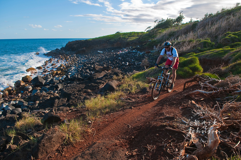 Mountain biking along the Kauai shoreline, Hawaii