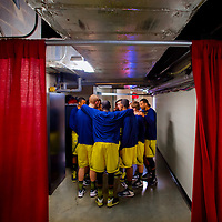 BLOOMINGTON, IN -- February 3, 2013 -- University of Michigan players huddle up in the hallway at halftime in the belly of Assembly Hall against the Indiana University Hoosiers in Bloomington, Indiana.  (PHOTO / CHIP LITHERLAND)