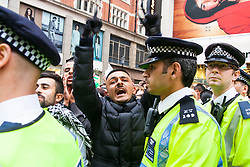 London, July 11th 2014. Police contain the crowds as thousands of Palestinians and their supporters demonstrate against the latest wave of Israeli retaliatory attacks on Palestinian targets and homes, where casualties are steadily mounting.