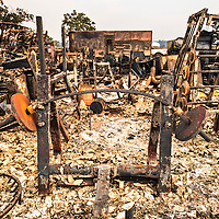 A steel barbell warped under the heat of a structure burned in the Valley Fire in Middletown, CA. <br /> <br /> Wreckage in the aftermath of the Valley Fire in Lake and Sonoma Counties Monday September 14th, 2015. As of Monday evening the fire had burned over 60,000 acres and was 10% contained. The Associated Press reported that at least one person was killed due to the fire.
