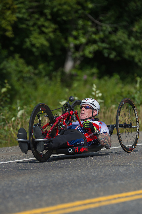 July 25, 2015: Kenny Herriot races along the Parks Highway during stage six of the 2015 Alaska Challenge handcycle race.