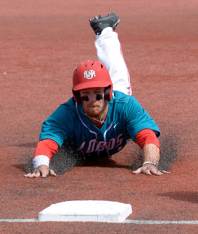 gbs032217bb/SPORTS -- UNM's Jared Mang slides safely into third base in the fourth inning of the game against Grand Canyon University at the Santa Ana Star Field on Wednesday, March 22, 2016. (Greg Sorber/Albuquerque Journal)