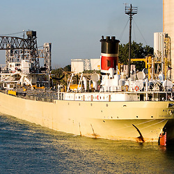 A large grain vessel is being loaded at a grain elevator on Lake Calumet on the south side of Chicago, IL.