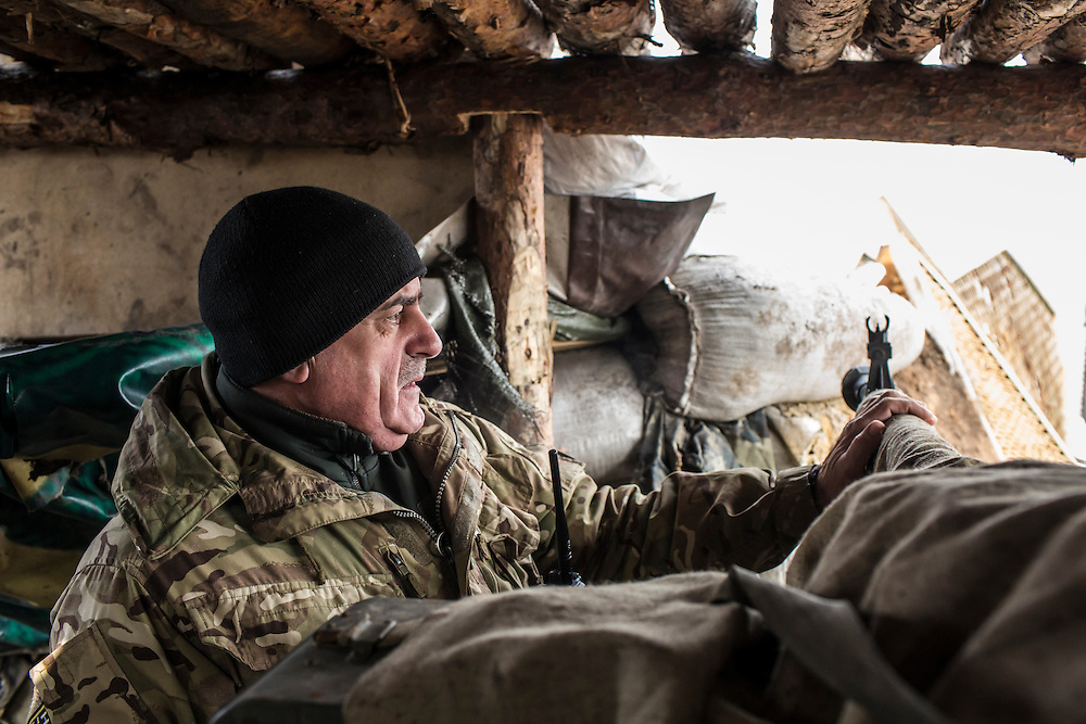 MARIINKA, UKRAINE - FEBRUARY 21, 2016: Lt. Col. Mikhailo M. Prokopiv, commander of Ukrainian Army forces in Mariinka, looks toward territory held by pro-Russian rebels at a front-line position in Mariinka, Ukraine. The Donetsk suburb has been the scene of some of the heaviest fighting recently between Ukrainian forces and pro-Russian rebels. CREDIT: Brendan Hoffman for The New York Times