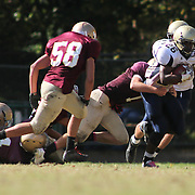 10/20/12 - Wilmington, DE - St. Elizabeth Football - Delaware Military Academy Tevin Williams (22) rushes  extra yardage during a Week 7 DIAA football game against St. Elizabeth Saturday, Oct. 20, 2012, at Baynard Stadium in Wilmington DE.   ..SAQUAN STIMPSON/Special to The News Journal