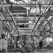 Chassis carrier on tire loader conveyor line of final line with view to upper level Chrysler Newark main assembly plant,HDR image Black and White