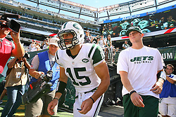 Sept 9, 2012; East Rutherford, NJ, USA; New York Jets quarterback Tim Tebow (15) runs onto the field during the pre-game warmup for their game against the Buffalo Bills at MetLIfe Stadium.