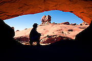 UT00105-00...UTAH - Hiker at Eye Of The Whale Arch in Arches National Park.