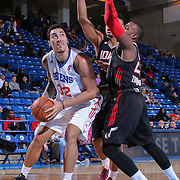 Delaware 87ers Forward Drew Gordon (32) drives towards the basket as Idaho Stampede Forward Jerrelle Benimon (50) defends in the first half of a NBA D-league regular season basketball game between the Delaware 87ers and the Idaho Stampede (Utah Jazz) Tuesday, Feb. 03, 2015 at The Bob Carpenter Sports Convocation Center in Newark, DEL