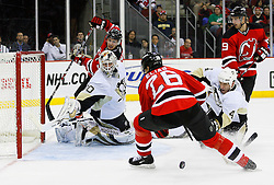 Dec 10, 2008; Newark, NJ, USA; Pittsburgh Penguins defenseman Rob Scuderi (4) poke checks the puck away from New Jersey Devils left wing Patrik Elias (26) during the second period at the Prudential Center.