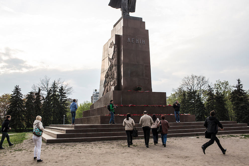KHARKIV, UKRAINE - APRIL 22: Volodymyr Varshavskiy (C), a blogger and local mechanic who is seeking to take the office of Kharkiv regional governor through a quasi-democratic popular mandate, walks to lay flowers at the base of a statue of Russian revolutionary leader Vladimir Lenin on Freedom Square on what would have been his 144th birthday on April 22, 2014 in Kharkiv, Ukraine. Pro-Russian activists have been occupying government buildings and demanding greater autonomy in many Eastern Ukrainian cities in recent weeks. (Photo by Brendan Hoffman/Getty Images) *** Local Caption *** Volodymyr Varshavskiy
