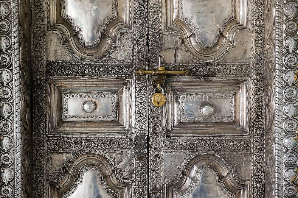 Deatil of the shrine room silver door.