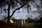 An abandoned home is burned and covered in gang tags in the Parklawn neighborhood in Modesto, Calif., February 22, 2012.