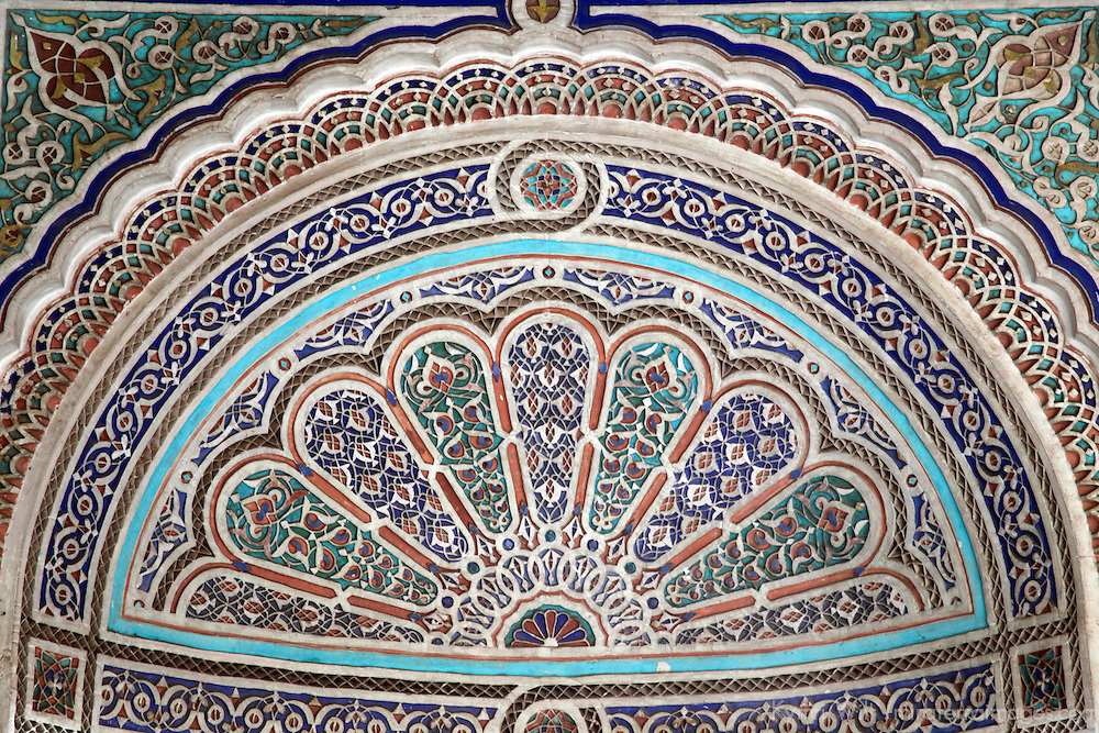 Africa, Morocco, Marrakech. Painted stucco detail at El Bahia Palace.