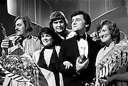 Victory celebrations at the sixteenth National Song Contest. Shay Healy (left), who wrote the winning song &lsquo;What&rsquo;s Another Year&rsquo;, with singer Johnny Logan and comp&egrave;re Larry Gogan (right), at RT&Eacute; Montrose, Dublin.<br />9 March 1980