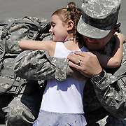 Lia McBurnie, 3, hugs her father, Sgt. Steve McBurnie, after his arrival Friday afternoon at the National Guard armory in Auburn.  Sgt. McBurnie, of Phoenix, was one of 14 soldiers with the New York Armory National Guard's 206th Military Police Company to be welcomed home in Auburn after a 10-month deployment in Iraq.<br /> <br /> Sam Tenney / The Citizen
