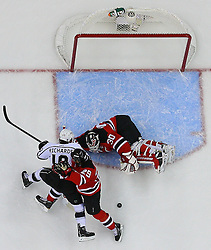 June 2; Newark, NJ, USA; Los Angeles Kings center Mike Richards (10) and New Jersey Devils defenseman Mark Fayne (29) battle for the loose puck after a save by New Jersey Devils goalie Martin Brodeur (30) during the second period of the 2012 Stanley Cup Finals Game 2 at the Prudential Center.