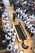 Milwaukee Archdiocesan Choir director leads choir members in song during a service at the Cathedral of St. John the Evangelist. (Photo by Sam Lucero)
