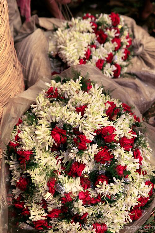 Asia, India, Calcutta. Garlands of rose and freesia in the flower market in Calcutta.