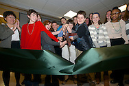 Students of the Green Woods Charter School cut the ribbon at their new facility on Monday