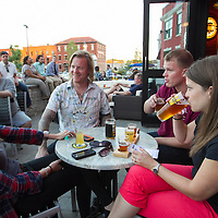 From left, Rita Millerman of Detroit, Josh Lyford of Worcester, Nick Lyford of Worcester and Laura Socha of Boston enjoy a pint of beer on the patio of the tap room at Wormtown Brewery in Worcester, Massachusetts room on August 28, 2015.  Matthew Healey for The Boston Globe<br /> <br /> (MAGAZINE Story Editor Francis Storrs, Assigning editor Jim Wilson, Visuals editor Lloyd Young)