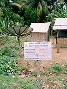 Local phone exchange with satellite dish on North Andaman Island