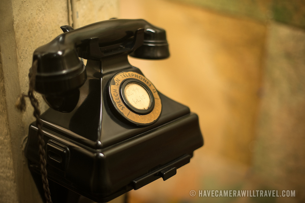 A telephone at the Churchill War Rooms in London. The museum, one of five branches of the Imerial War Museums, preserves the World War II underground command bunker used by British Prime Minister Winston Churchill. Its cramped quarters were constructed from a converting a storage basement in the Treasury Building in Whitehall, London. Being underground, and under an unusually sturdy building, the Cabinet War Rooms were afforded some protection from the bombs falling above during the Blitz.