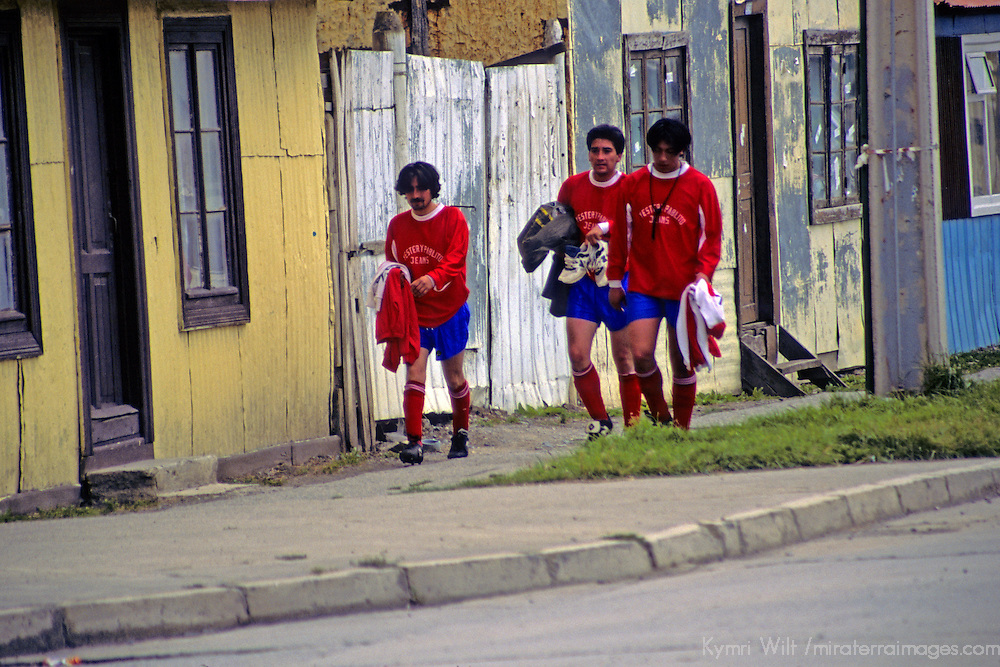 Americas, South America, Chile, Puerto Natales. Players walk home after the local futbol(soccer) match.