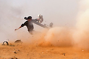 A Libyan rebel fires a recoilless rifle at a government aircraft during heavy clashes with pro- Qaddafi forces on the front line near Brega. The control of Brega, a key eastern oil town, is crucial for the rebel advance.