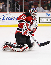 Oct 17, 2009; Newark, NJ, USA; New Jersey Devils goalie Martin Brodeur (30) makes a save during the third period of their game against the Carolina Hurricanes at the Prudential Center. The Devils defeated the Hurricanes 2-0.