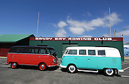 1955 Volkswagon VW Kombi Bus.Chestnut Brown & Ceiling Wax Red.1962 Volkswagon VW Kombi Bus.Green & White.Sandy Bay Rowing Club.Sandy Bay, Hobart, Tasmania .16th February 2008.1955 model, It was built in the Wolfsburg Factory in Germany on 23rd of March 1955. It is a very rare bus indeed, as they were not built in that factory for very long. Less that 6 months of production. It is one of the earliest 55s in the world. It is specked as a Deluxe, with all genuine original parts (No reproduction parts used, apart from side step). It is running 1968 lowered beam & brakes It is also running a 1641 Remtec motor; with twin type 3 carbs, an L-Bug gearbox & IRS suspension.. 1962 model, very rare bus, as is 100% original steel. When found, was completely unrestored & in perfect, rust free condition. Basically stock running gear, apart from a later model gearbox & a 1600 motor..(C) Joel Strickland Photographics.Use information: This image is intended for Editorial use only (e.g. news or commentary, print or electronic). Any commercial or promotional use requires additional clearance.