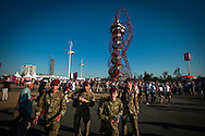 British soldiers walk past the ArcelorMittal Orbit sculpture on the Olympic Park built for the London 2012 Olympic Games.