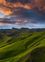 Sunset and lush green countryside near Vik, Iceland